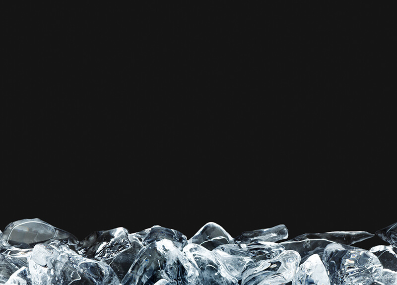 Mound of ice cubes in front of black background